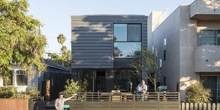 Universal design and affordability were uppermost in the minds of TJ Hill and Jay Heiserman when they asked Jared Levy and Gordon Stott of Connect Homes to replace their cramped bungalow with a modern prefab. Since the firm's modules are 8 feet wide, the house could only be 16 feet wide, but the architects used the remaining space for a large deck, creating a flexible and seamless first-floor plan.