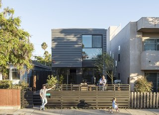 """We always knew we wanted to do prefab—here it is something interesting and beautiful that adds to the character of the street,"" says TJ (on deck, with Jay, left, and Chloe). ""There weren't many options for staying in the area with a growing family,"" notes Stott."