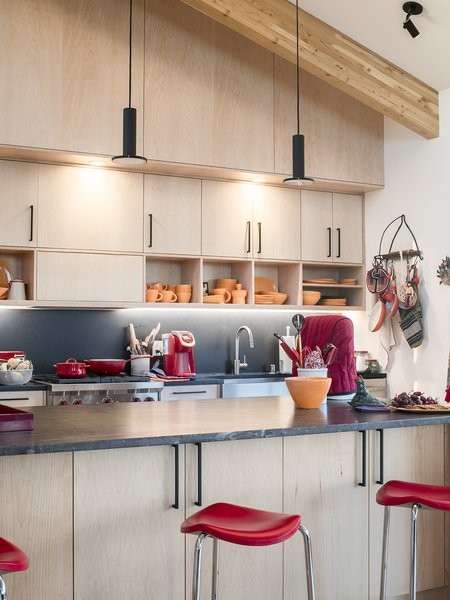 The kitchen cabinets hold dishes by Butterpie Productions. - Taos, New Mexico Dwell Magazine : July / August 2017  Photo 5 of 11 in A Rookie Designer and Her Builder Father Create an Artist's Sculptural Loft in the Desert