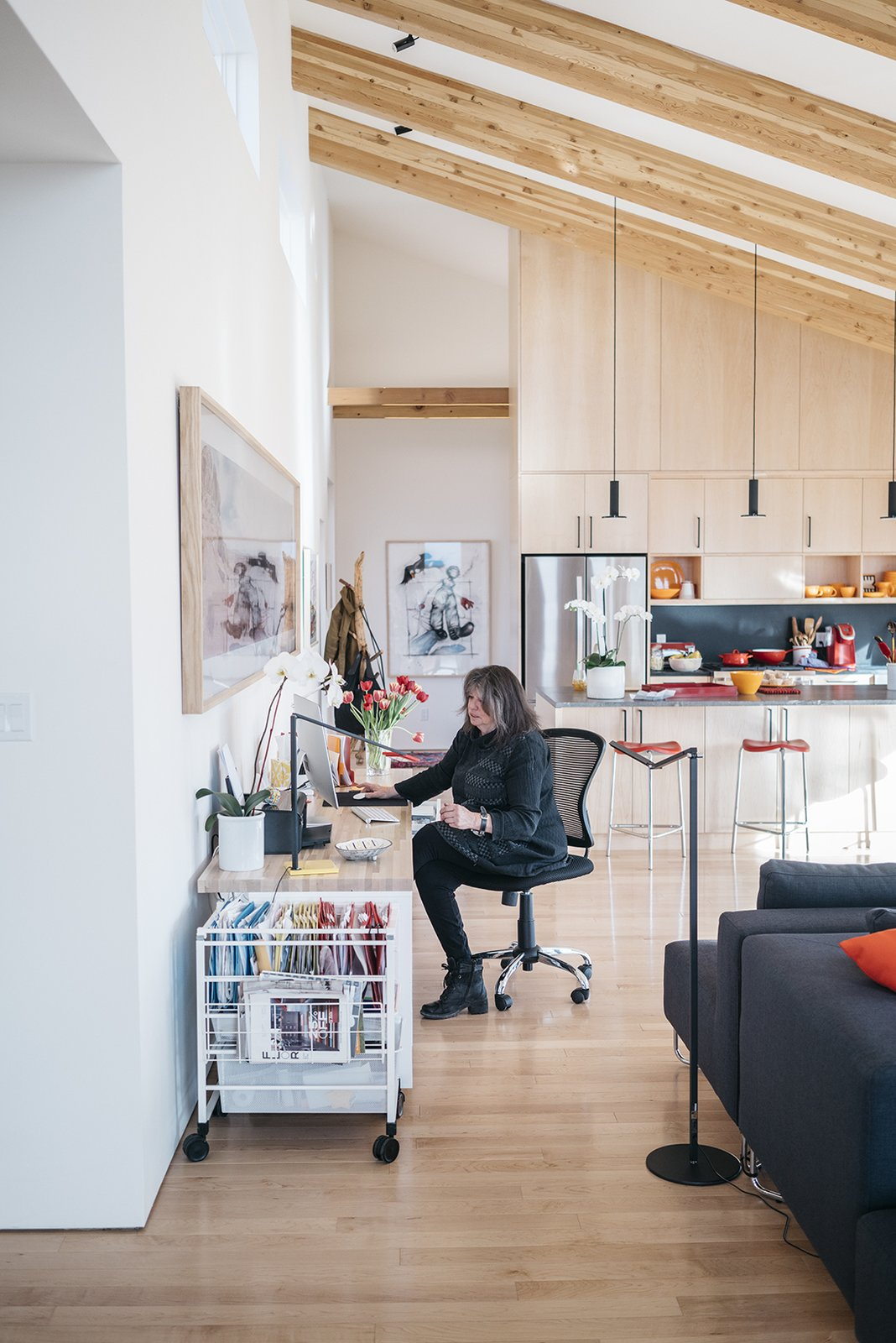 Office, Craft Room Room Type, Chair, Desk, Storage, Lamps, and Light Hardwood Floor - Taos, New Mexico Dwell Magazine : July / August 2017  Photo 9 of 11 in A Rookie Designer and Her Builder Father Create an Artist's Sculptural Loft in the Desert