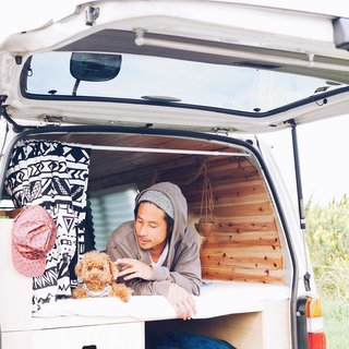 A Japanese couple and their fluffy pooch Roy are traversing the heartland of Japan in their stylish, wood-paneled abode.