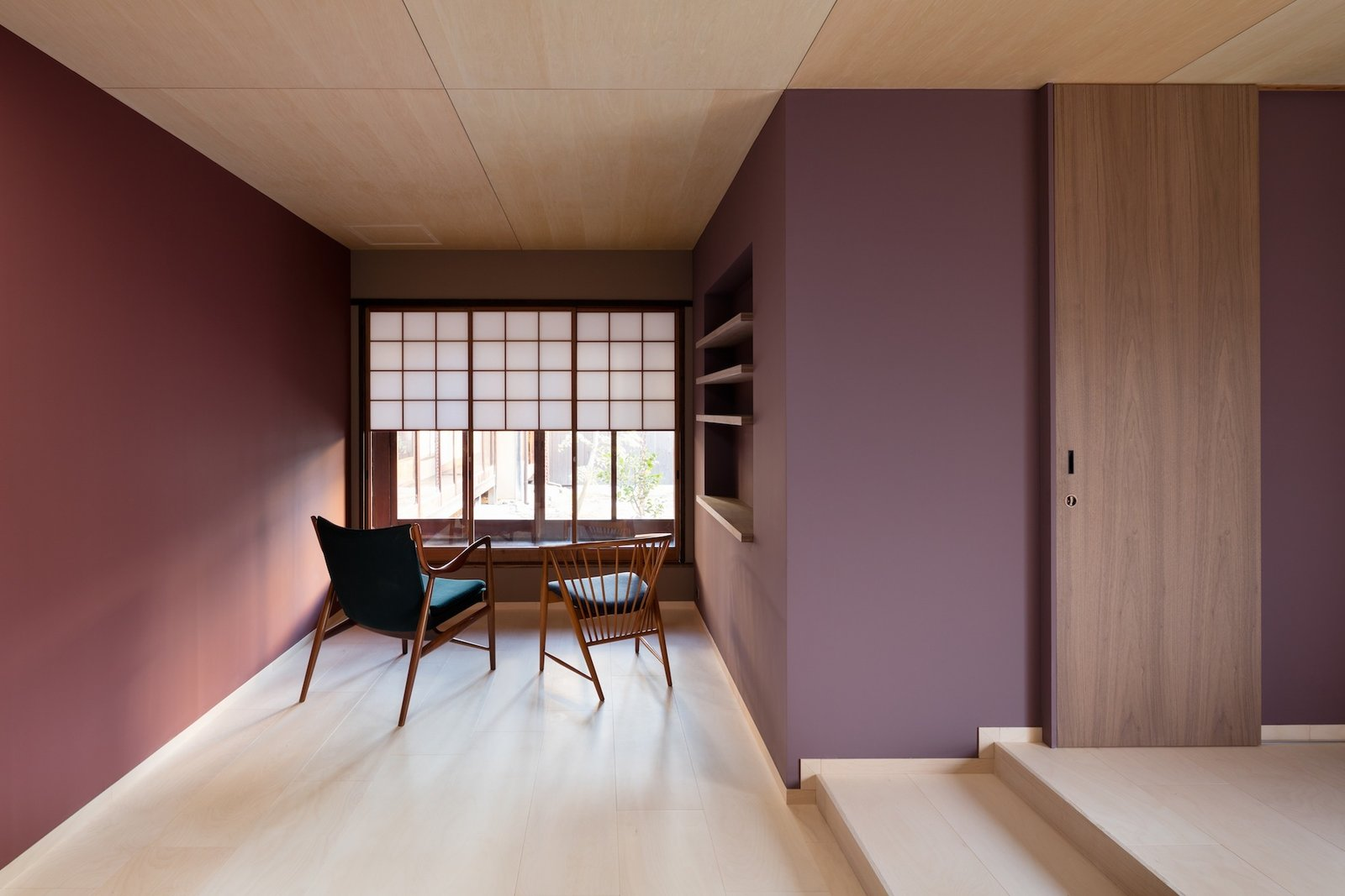 Living Room, Chair, Light Hardwood Floor, and Shelves  Nichinichi Townhouse from A Minimalist Townhouse Provides Serene Accommodations in Historic Kyoto