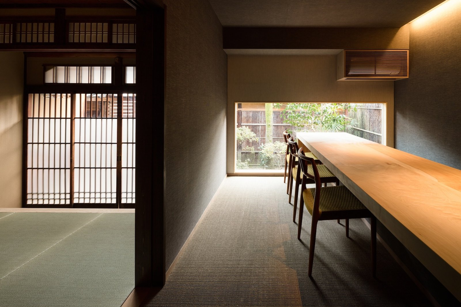 Dining Room, Table, Chair, Recessed Lighting, and Carpet Floor  Photo 10 of 13 in A Minimalist Townhouse Provides Serene Accommodations in Historic Kyoto