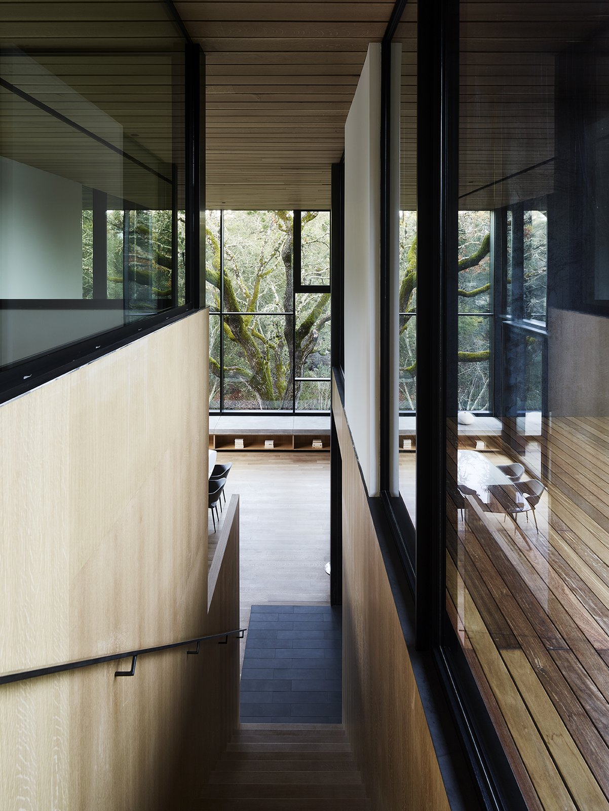 Staircase, Metal Railing, and Wood Tread  Photo 8 of 14 in Nature Drove the Design of This Sculptural, Cor-Ten Steel House in Northern California