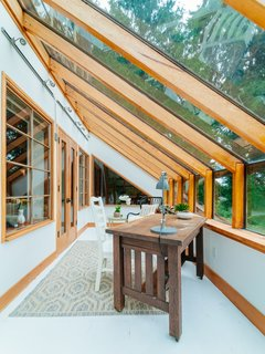 Repurposed Ship Materials and 100-Year-Old Beams Make Up This Tree House-Like Home - Photo 13 of 18 -