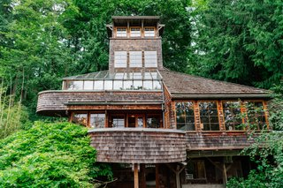 Repurposed Ship Materials and 100-Year-Old Beams Make Up This Tree House-Like Home