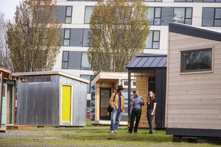 Shown here are the architect-designed PODs on display in downtown Portland. Beyond providing structures, the POD Initiative is also changing perceptions about houselessness among Portlanders so that these communities can eventually be integrated into the city's fabric.