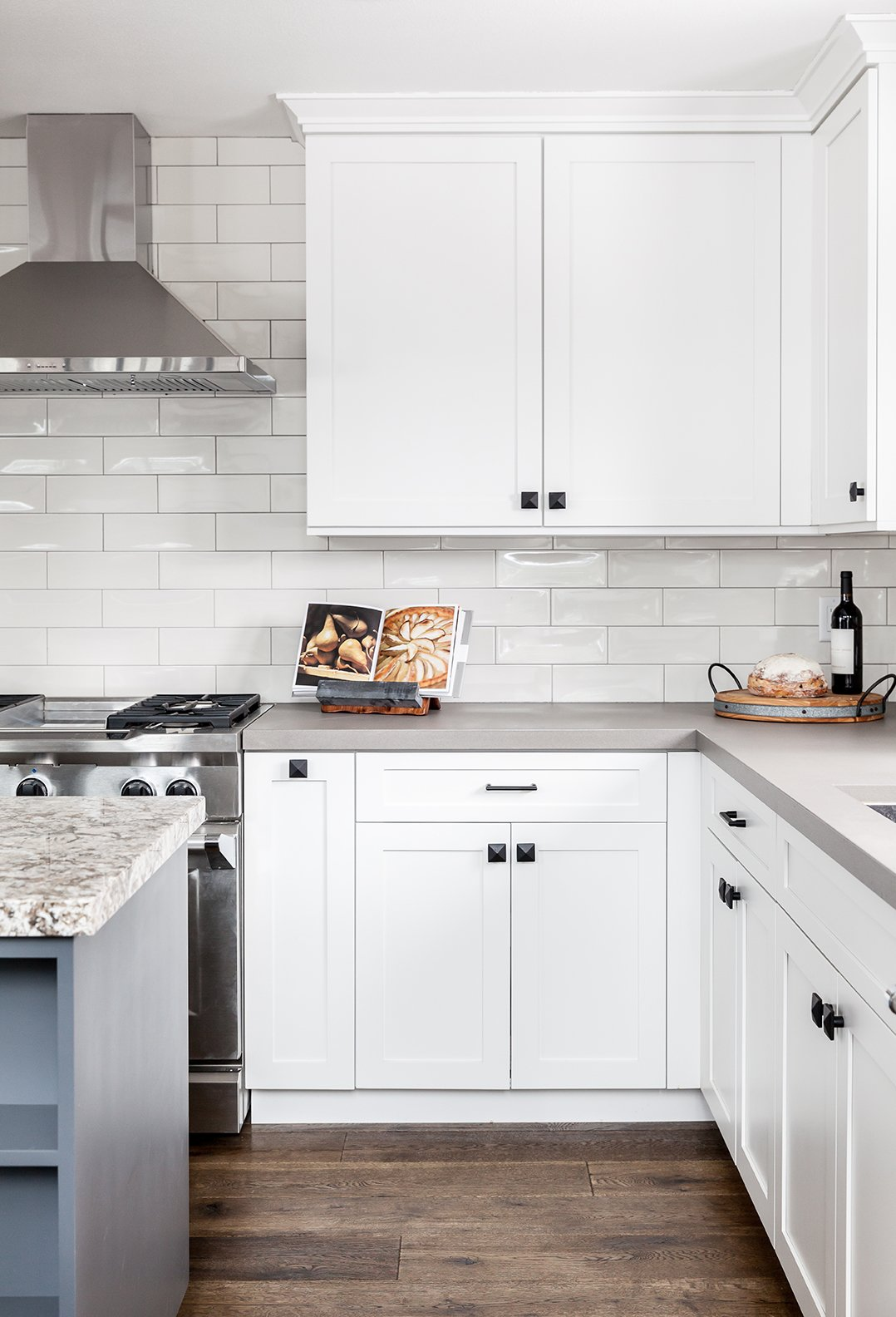 Kitchen, Range, Range Hood, and Subway Tile Backsplashe  Dwell Magazine : September / October 2017  Photo 4 of 6 in In This A-Frame Cabin Makeover, Simplicity Is Key