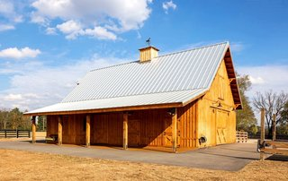 10 prefab barn companies that bring diy to home building for Red barn prefab