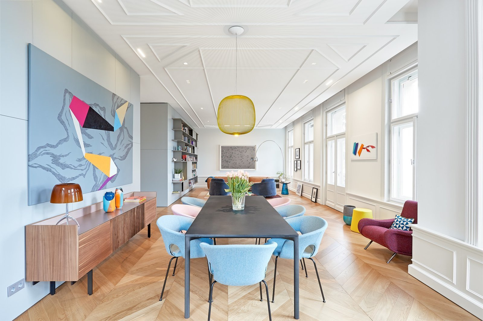 Dining Room, Table, Medium Hardwood Floor, Pendant Lighting, and Chair  Photo 1 of 17 in A Family Villa in Budapest With Colorful, 1960s-Inspired Interiors