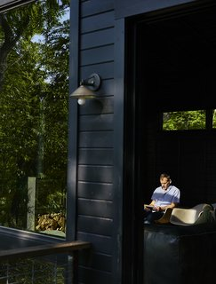 A recessed sliding door by Jeld-Wen opens from the kitchen onto a perch deck.