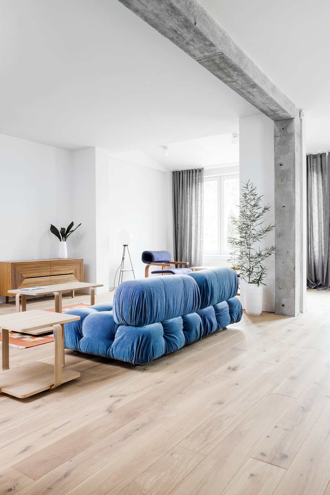Living Room, Sofa, and Light Hardwood Floor  Photo 11 of 12 in A Family's Loft in Poland Gets a Minimalist Renovation That's Both Elegant and Functional