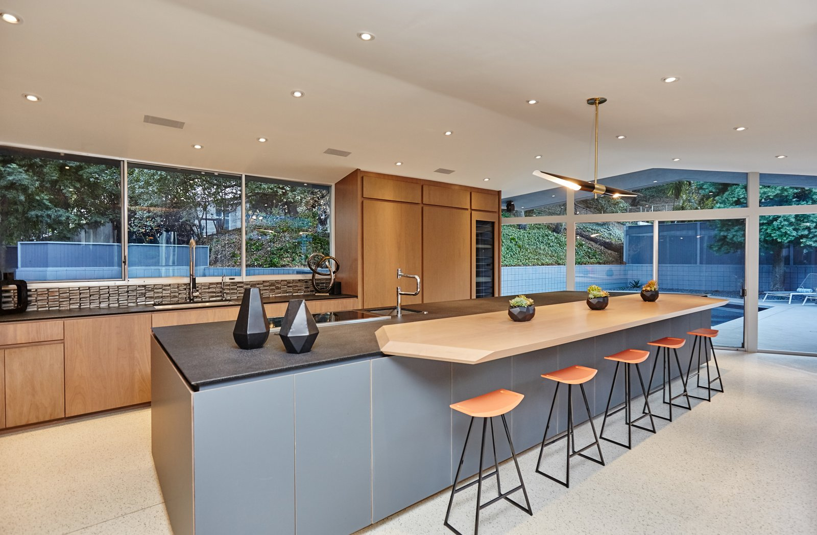 Kitchen, Granite Counter, Terrazzo Floor, Wood Cabinet, and Recessed Lighting  Photo 6 of 10 in A Hexagonal Midcentury Residence in Southern California Offered at $2.89M