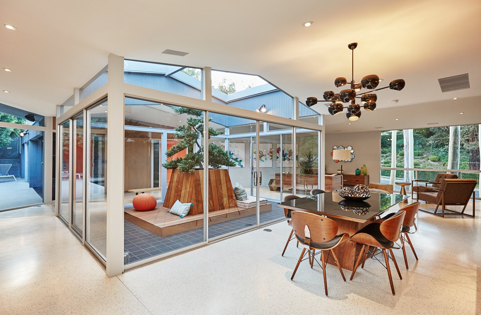 Dining Room, Table, Chair, Pendant Lighting, and Terrazzo Floor  Photo 5 of 10 in A Hexagonal Midcentury Residence in Southern California Offered at $2.89M
