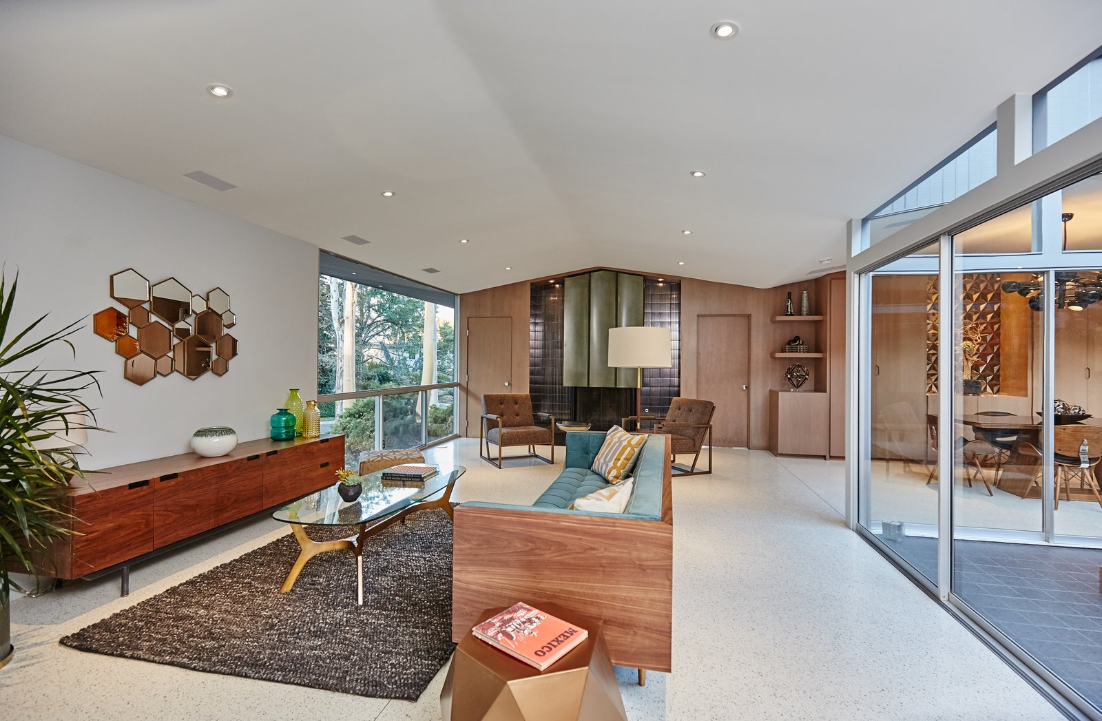 Living Room, Sofa, Chair, Coffee Tables, Console Tables, Floor Lighting, Terrazzo Floor, and Standard Layout Fireplace  Photo 3 of 10 in A Hexagonal Midcentury Residence in Southern California Offered at $2.89M
