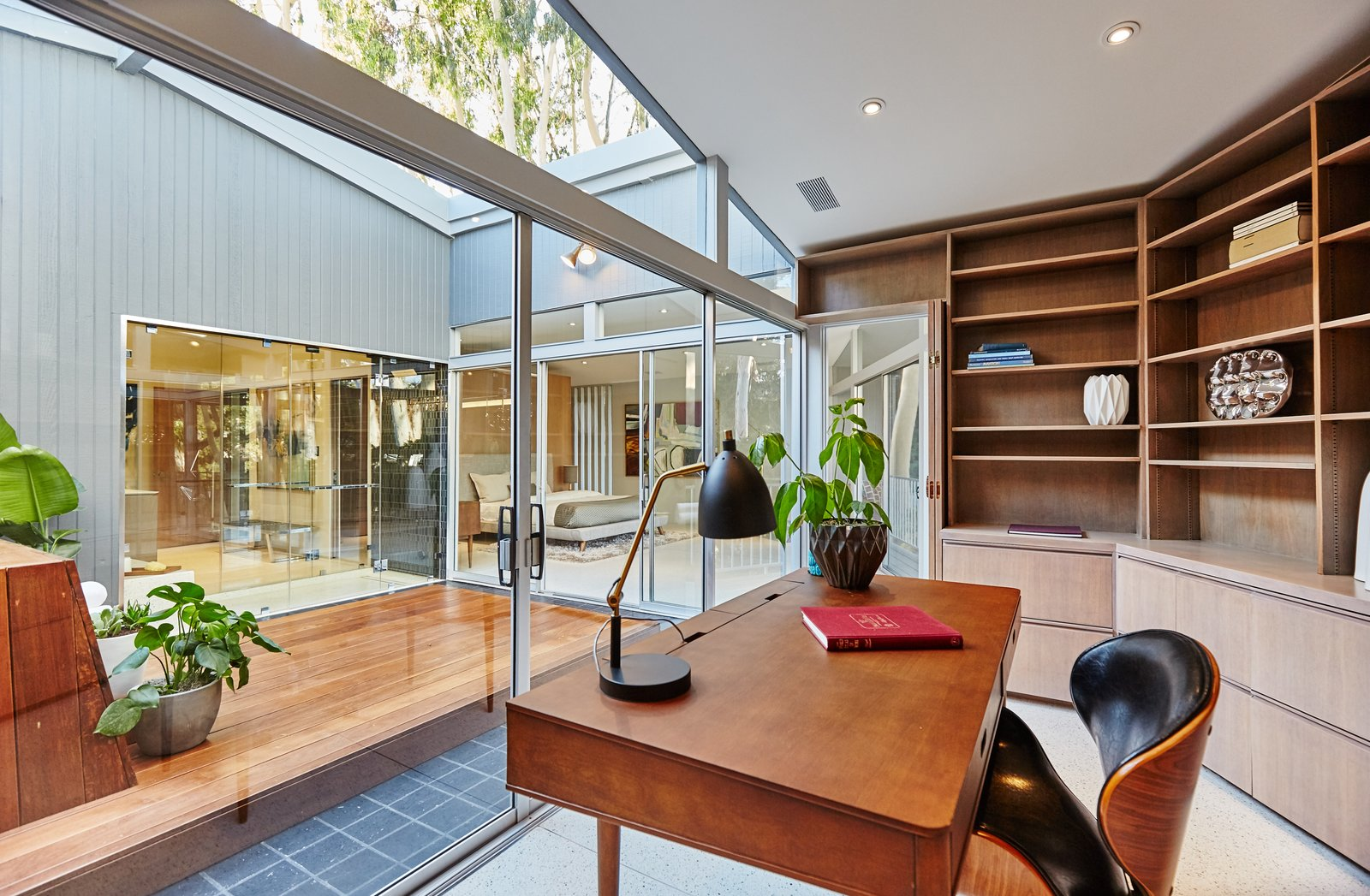 Office, Library, Chair, Shelves, Bookcase, Desk, Lamps, and Terrazzo  Office Terrazzo Photos from A Hexagonal Midcentury Residence in Southern California Offered at $2.89M