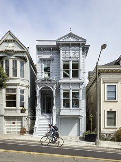 The home's facade went through a laborious five-month reconstruction process, and when complete, was bathed in a demure coat of metallic silver paint.