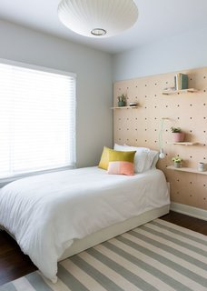 The second bedroom has a trundle twin bed and is finished with a quirky wooden wall treatment.