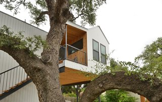 Feel at Home While Exploring Austin at One of These Modern Short-Term Rentals - Photo 5 of 17 - The studio is surrounded by large oak trees and offers expansive views of the surrounding rooftops.