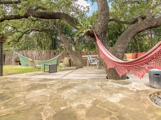 Feel at Home While Exploring Austin at One of These Modern Short-Term Rentals - Photo 17 of 17 - Connected to the main house by a breezeway, guests are able to enjoy the central outdoor space shared by the two homes.