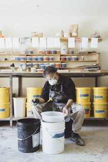 "Senior glaze technician Mushtaque Khan sifts particles at the company's factory near Salinas. All tiles at Fireclay are made to order by hand. The firm creates its own lead-free glazes in more than a hundred colors, along with custom shades. ""We have trouble saying no to color,"" says founder and chief ceramicist Paul Burns."