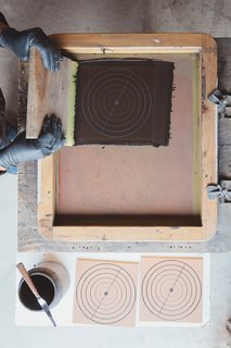 Patterning: Using a method inspired by the cuerda seca technique, hand-painted tiles are screen-printed with a dry line formula made with oil or wax to keep glazes separate during firing.
