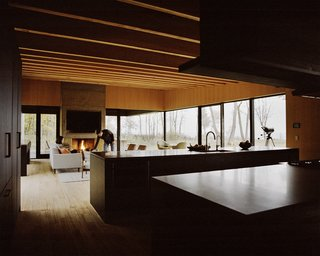 The residents went with a Control4 automation system to handle lighting, sound, and window shades; Traverse City–based Waara Technologies did the installation. A fireplace designed by Desai Chia and built by BRD anchors the living area.