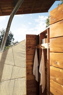 The open-air shower features a screen Moore wove from marine rope.