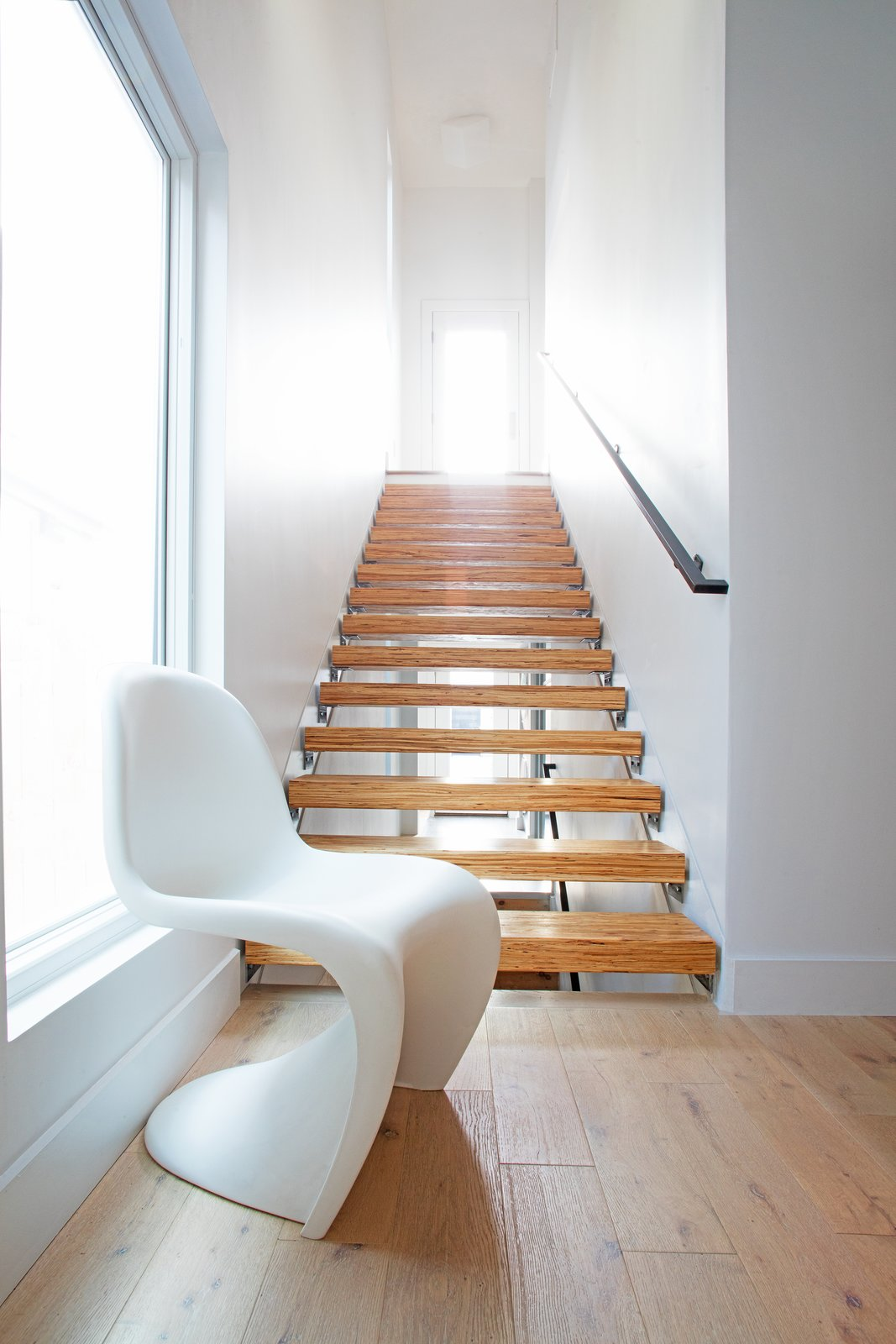 Staircase, Wood Tread, and Metal Railing  Best Photos from Clad in Cedar and Metal, an Indianapolis Home Gives a Modern Salute to its Traditional Surroundings