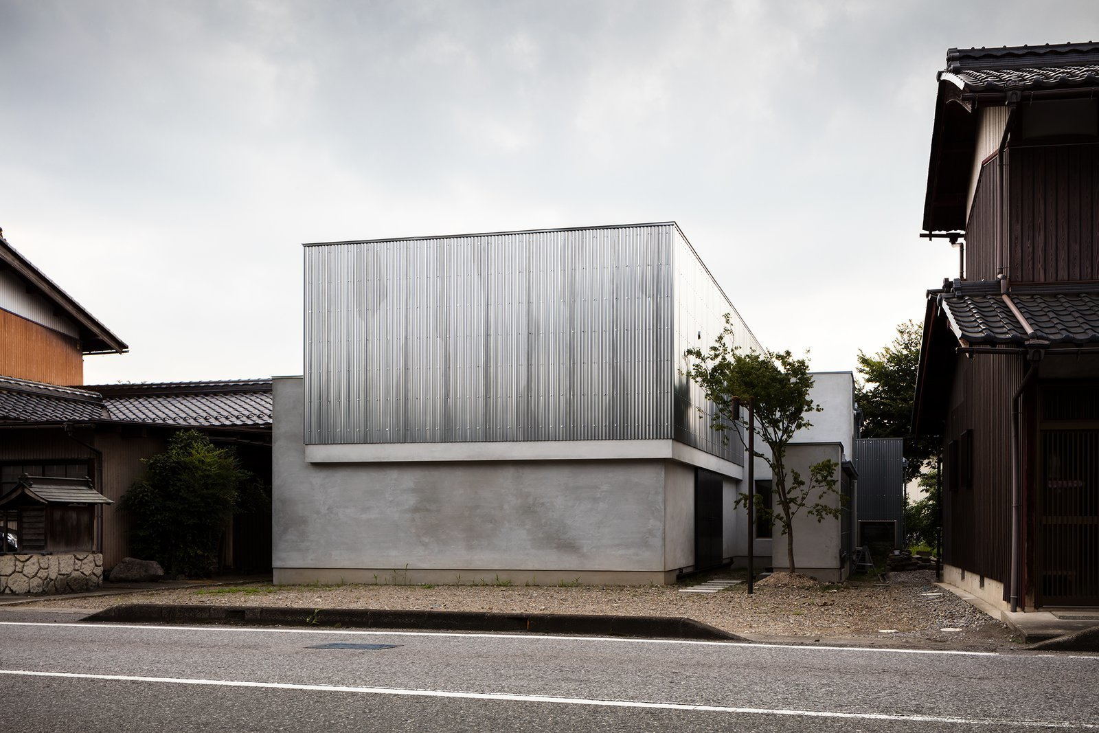 Exterior, Flat RoofLine, Metal Siding Material, Concrete Siding Material, and House Building Type  Photos from Find Out How a Japanese Architect Created a Fluid Live/Work Space For a Photographer