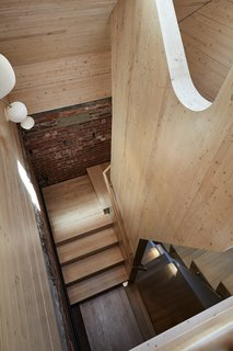 Gray Organschi Architecture performed the overhaul, including a 650-square-foot roof addition, reached by a wood staircase, that's part of a five-bedroom inn for musicians.