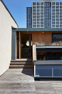The clerestories, located on the roof deck near the prefab addition, fill the loft with light.