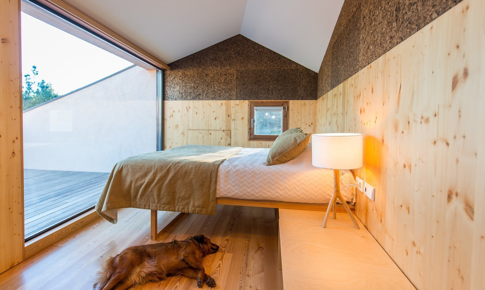 Bedroom, Bed, Lamps, Table Lighting, and Medium Hardwood Floor  Photo 3 of 16 in Stay in a Tiny, Eco-Friendly House in a Portuguese Schist Village