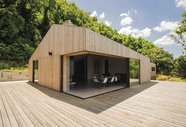 Exterior, House Building Type, and Wood Siding Material  Photo 2 of 14 in This Eco-Friendly Bed-and-Breakfast in Italy Is the Perfect Indoor/Outdoor Escape