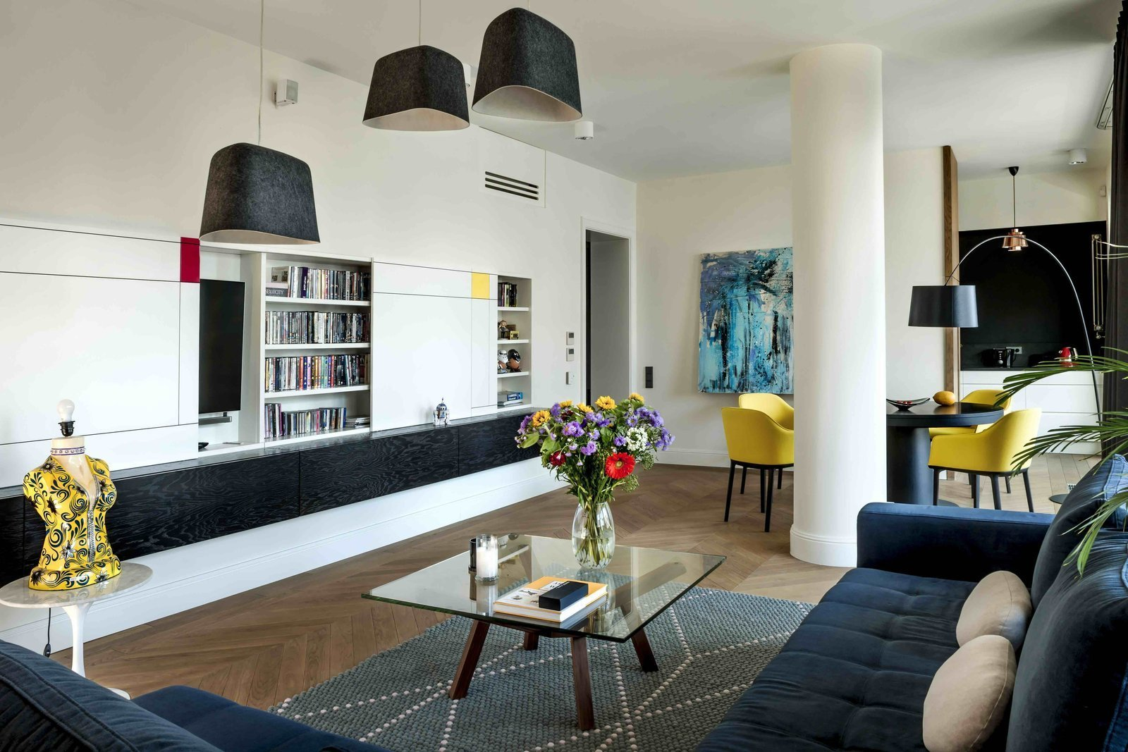 Living Room, Ceiling Lighting, Pendant Lighting, Sectional, and Coffee Tables  Photo 4 of 12 in Filled With Color and Pattern, This Eclectic Apartment Brings a Little Madrid to Warsaw