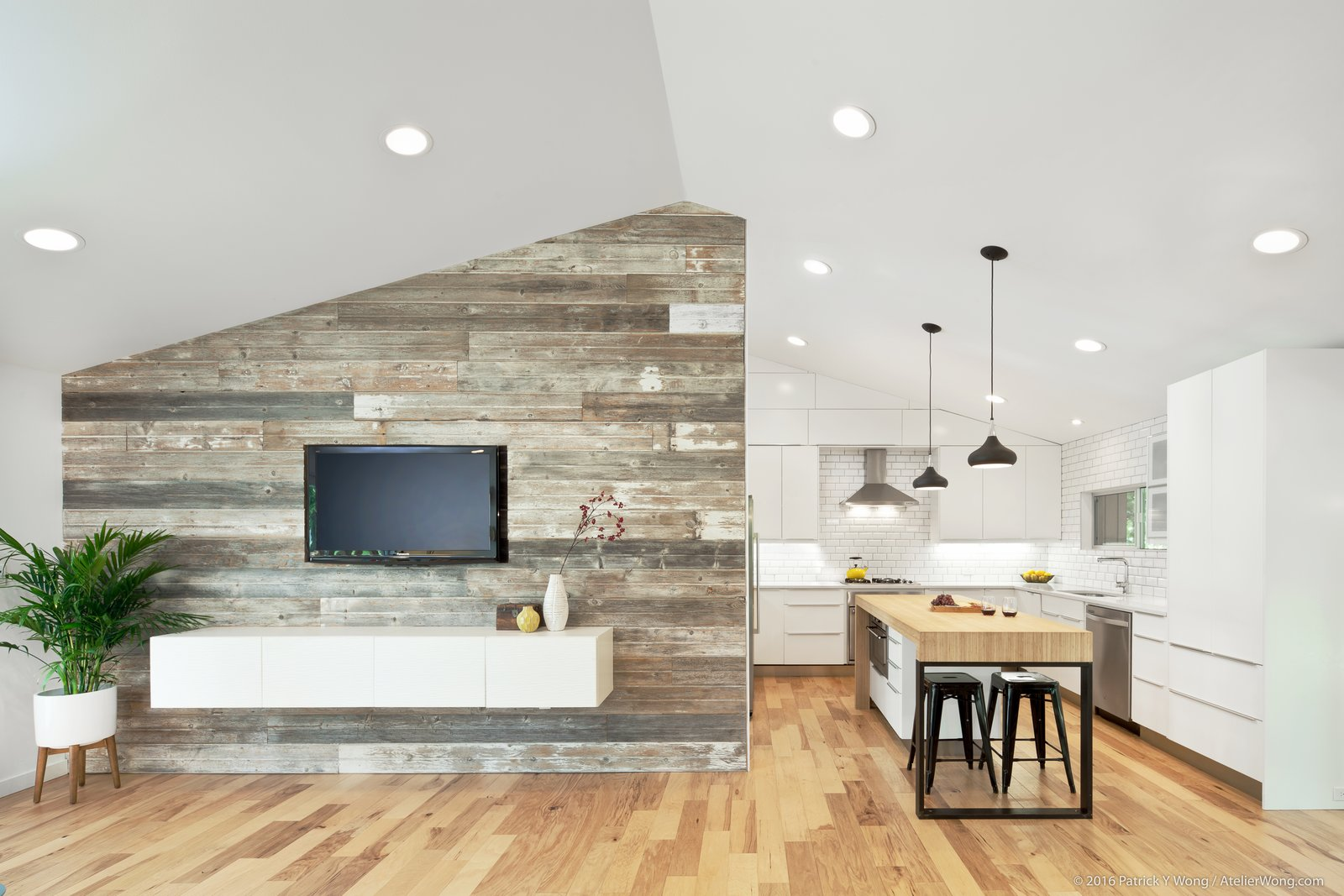 Kitchen, Medium Hardwood Floor, White Cabinet, Ceramic Tile Backsplashe, Recessed Lighting, and Pendant Lighting  Photo 6 of 14 in An Austin Couple Turn a Ranch Home Into a Refreshing Live/Work Space