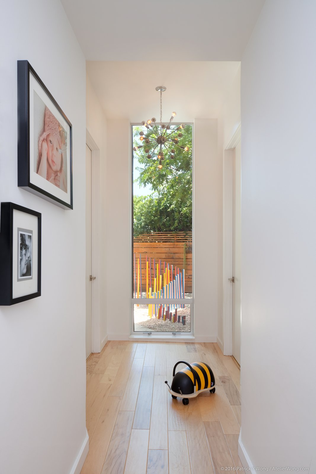 Hallway and Medium Hardwood Floor  Photo 9 of 14 in An Austin Couple Turn a Ranch Home Into a Refreshing Live/Work Space
