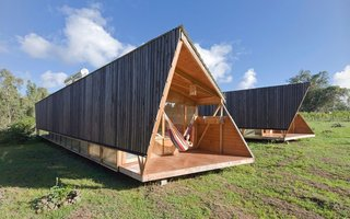 "The warm wood construction and sleek ""primitive-modern"" look captures the energy of the island."