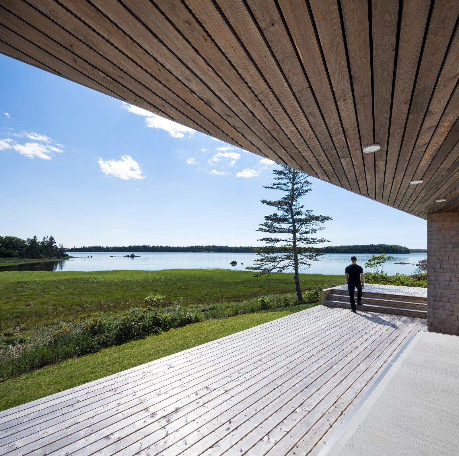 Outdoor, Large Patio, Porch, Deck, Wood Patio, Porch, Deck, Grass, and Back Yard  Photos from A Vacation Home in Nova Scotia Takes Cues From the Coastal Landscape