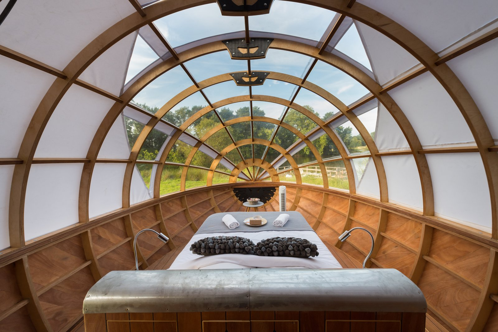 Bedroom, Bed, Accent Lighting, and Medium Hardwood Floor  Photo 2 of 7 in A Fantastic Egg-Shaped Camping Pod Along the Loire Estuary
