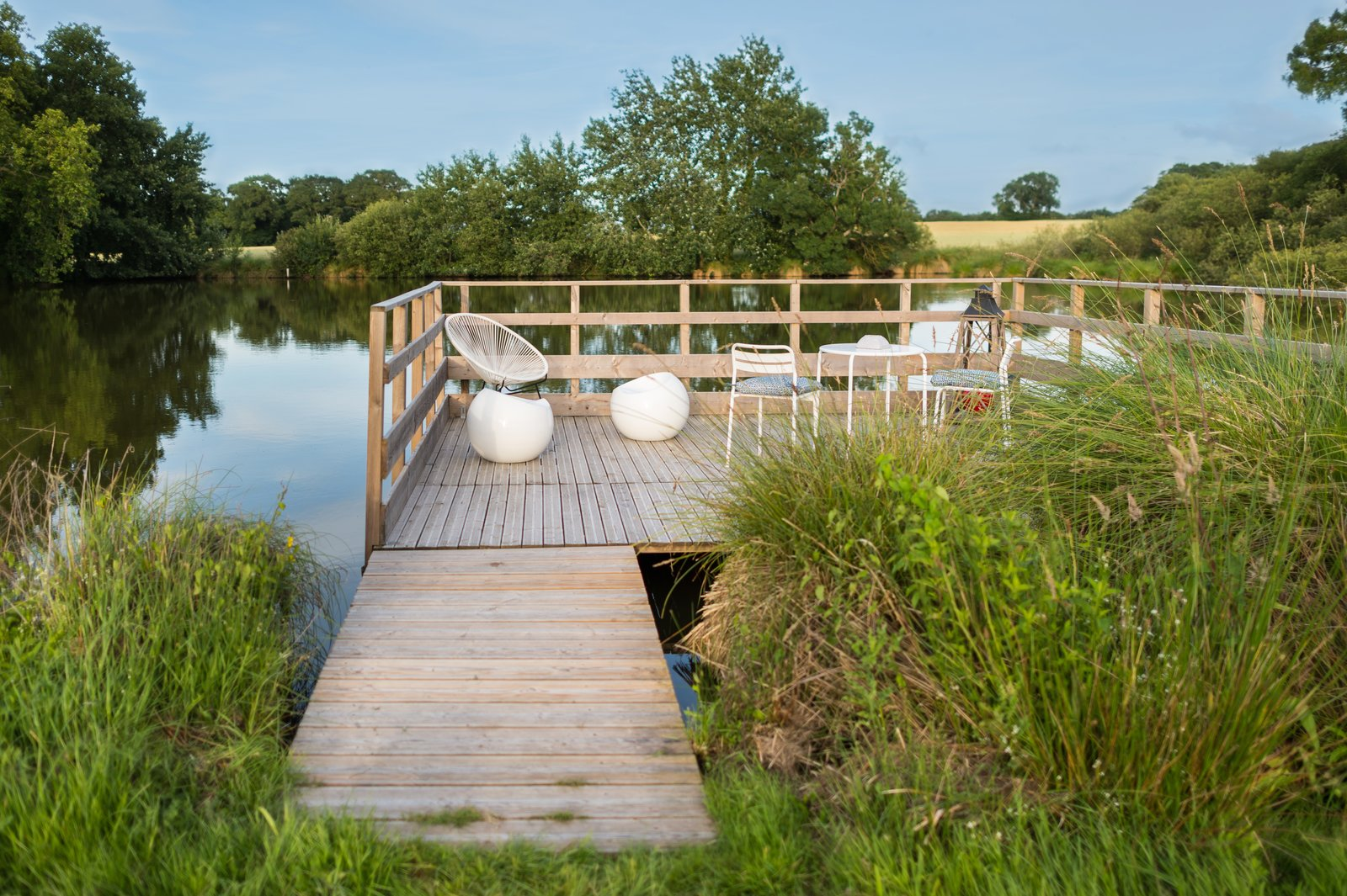 Outdoor, Wood Patio, Porch, Deck, Decking Patio, Porch, Deck, Wood Fences, Wall, Shrubs, and Back Yard  Photo 6 of 7 in A Fantastic Egg-Shaped Camping Pod Along the Loire Estuary