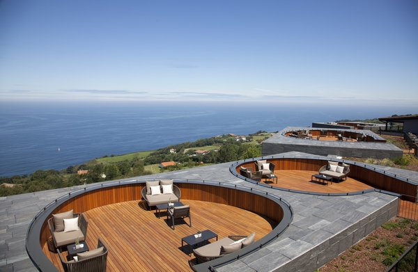 A shared outdoor space with breathtaking views features six slightly sunken decks for lounging and conversation