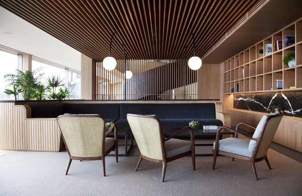 The common areas are completely paneled in wood, which creates a consistent thread throughout.