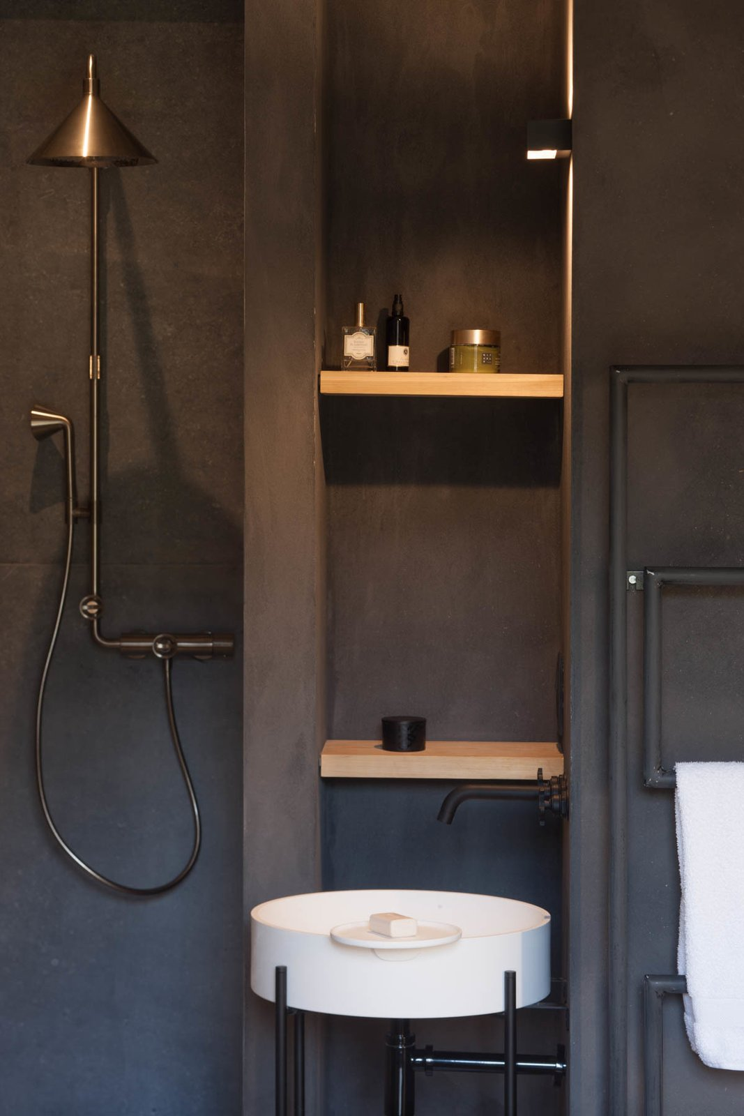 Bath Room, Pedestal Sink, Open Shower, Wall Lighting, and Concrete Wall  Photo 11 of 16 in Stay at an Old Converted Train Station in the Belgian Countryside