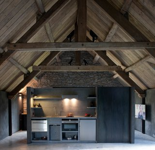 Stay at an Old Converted Train Station in the Belgian Countryside - Photo 8 of 15 - An additional kitchen was been placed in the loft for added convenience.