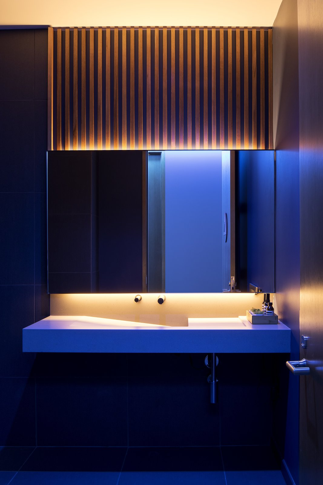 Bath Room, Undermount Sink, Accent Lighting, and Recessed Lighting  Photo 11 of 12 in A Healthcare Start-Up Combines Modern Design With Top-Notch Technology and Care