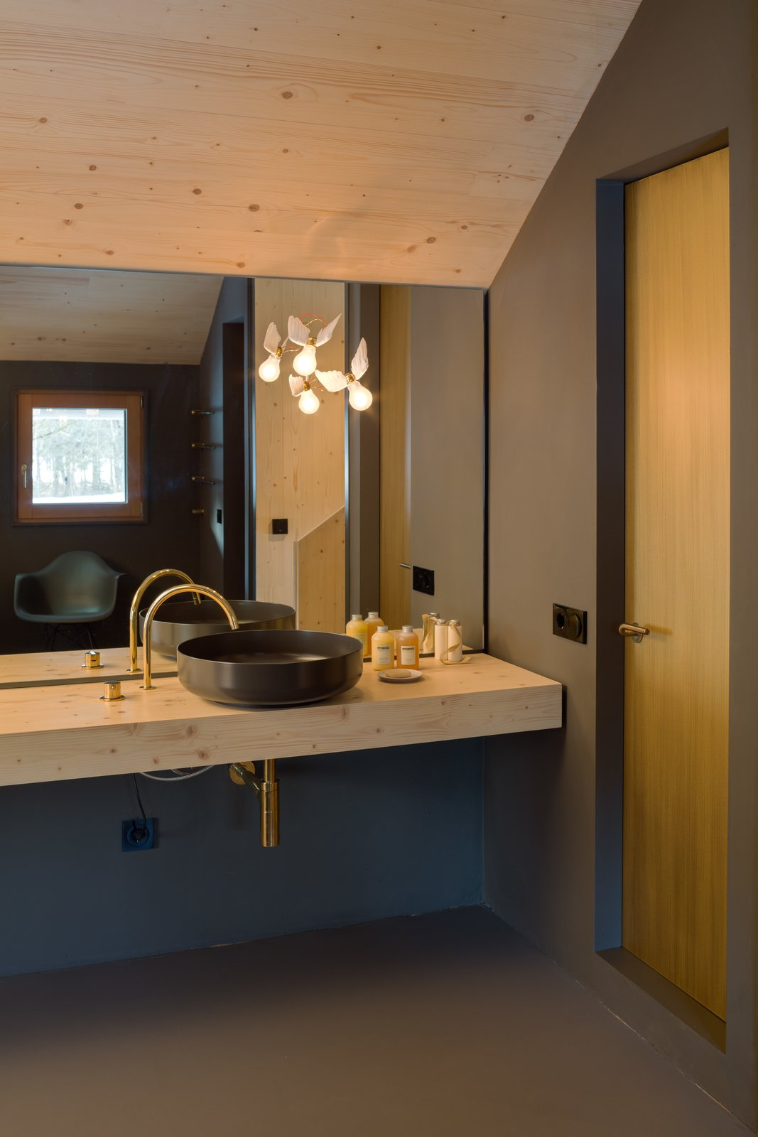 Bath Room, Wood Counter, Vessel Sink, and Wall Lighting  Photo 10 of 12 in A Peaceful Bavarian Retreat With Expansive Outdoor Terraces