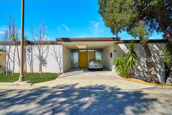 This Richard Banta-designed midcentury home is located at 1031 Berlin Drive in Glendale, California. The two-bedroom, two-bath house measures 1,218 square feet and sits on a 3,030-square-foot lot.