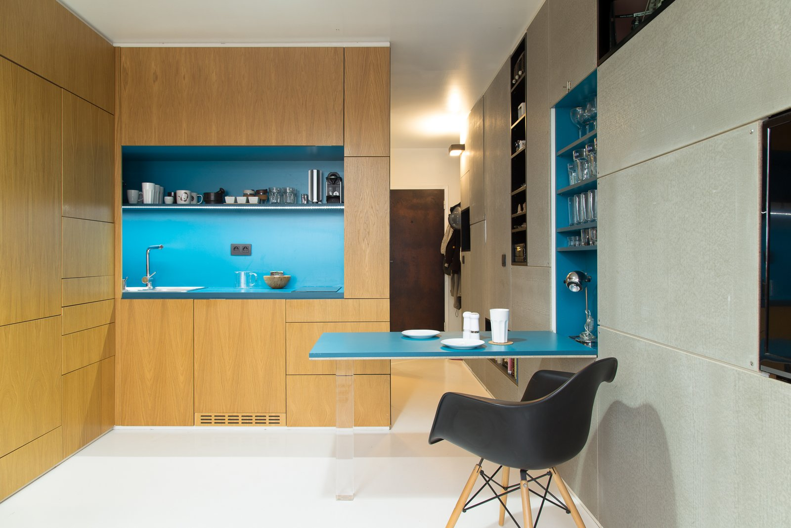 Kitchen, Drop In Sink, Open Cabinet, Colorful Cabinet, and Wood Cabinet  Photo 6 of 8 in A Tiny Apartment in Slovakia Makes Clever Use of Space