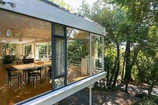 An Amazing Tree-Covered Glass House For Sale in the Berkeley Hills - Photo 2 of 20 - The cantilevered extension appears to float above the hillside.